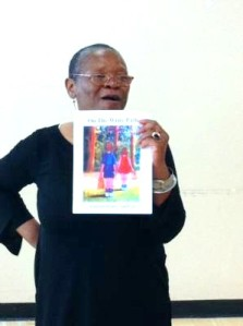 "Lorraine Currelley, SPARC 2014 Recipient holding ""On The Write Path, A Journal of Poetry and Prose"""